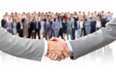 manos unidas: agitando las manos y equipo de negocios Foto de archivo