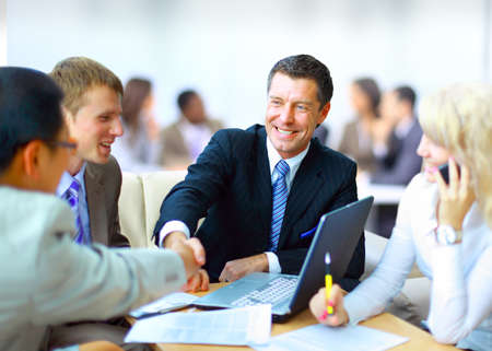 strong message: Business people shaking hands, finishing up a meeting Stock Photo