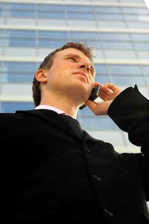 officetower: Young businessman calling on mobile phone, outdoor