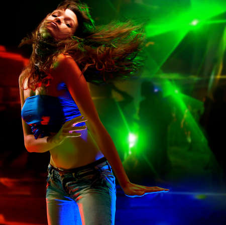 girl party: Beautiful young woman dancing in the nightclub