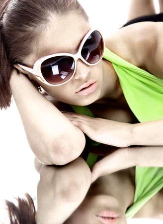 Woman in sun glasses. Fashion portrait Stock Photo - 23318490