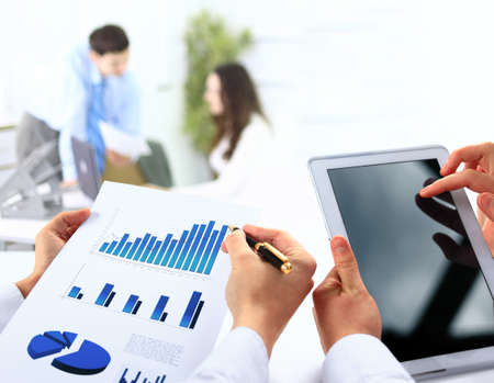 busienssman holding digital tablet in office photo