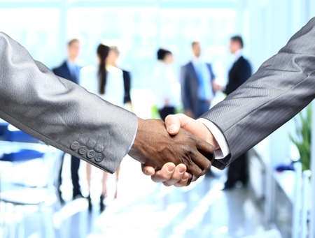 unanimous: Business people shaking hands