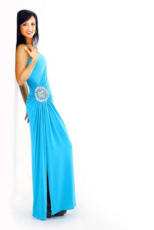 young woman in blue dress posing in studio photo