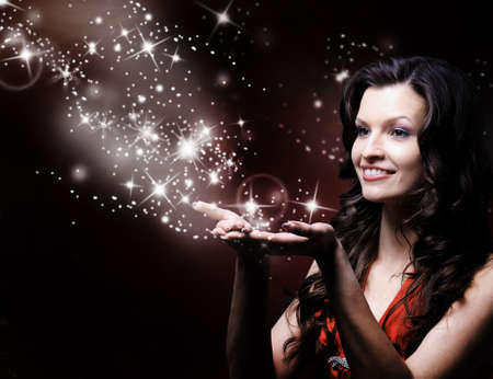 beautiful girl blowing magic stars photo