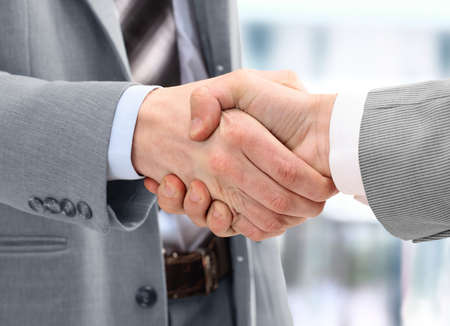 business partner: Photo of handshake of business partners after signing promising contract  Stock Photo