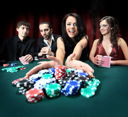 young beautiful woman playing in casino photo