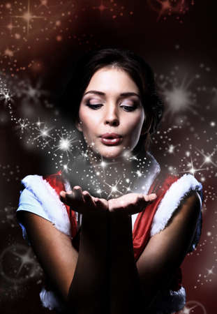 sexy xmas elf: young christmas woman holding magic stars