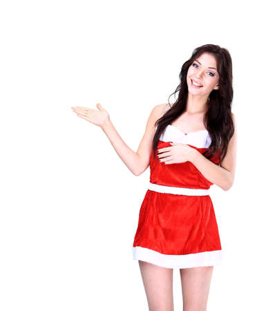 Christmas girl pointing to your message or product photo