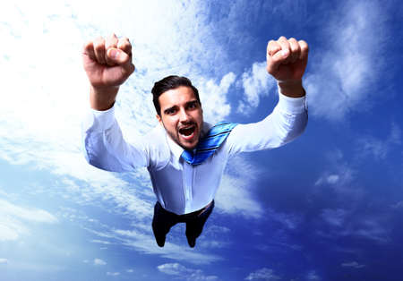 Happy businessman flying in the sky photo