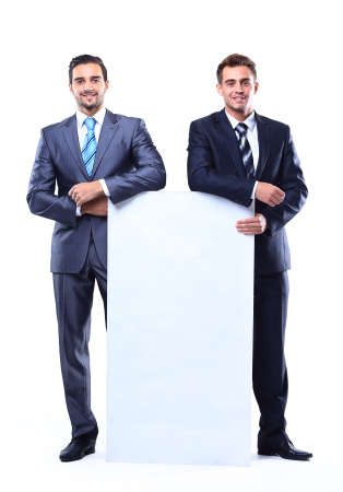 Two smiling business man showing blank signboard, isolated over white background photo