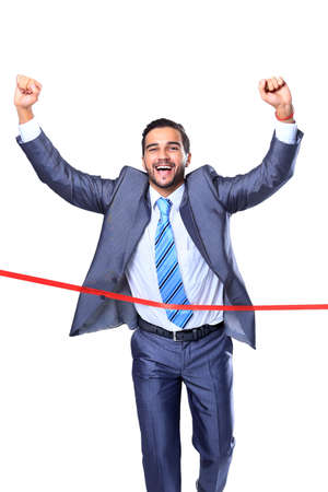 red competition: Happy businessman running through finishing line. Isolated on white