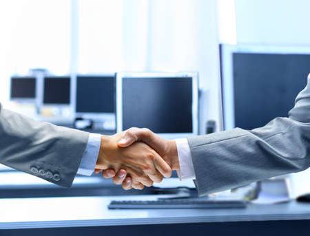 welcome business: Business people shaking hands