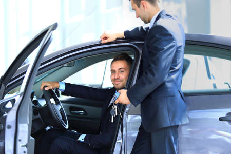auto leasing: man buying a new car