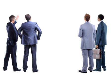 four business mans from the back - looking at something over a white background photo