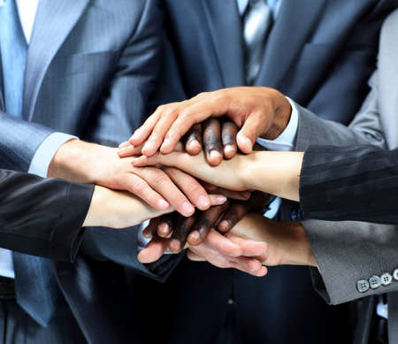 joining together: Closeup portrait of group of business people with hands together Stock Photo