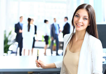 front desk: Young businesswoman and her colleagues Stock Photo