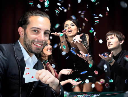 casino table: Poker players sitting around a table at a casino Stock Photo