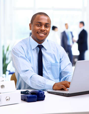 Portrait of a handsome young business man with a laptop  Stock Photo