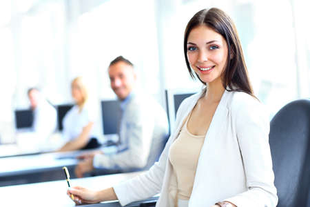 young office workers: Business woman with her team at the office Stock Photo