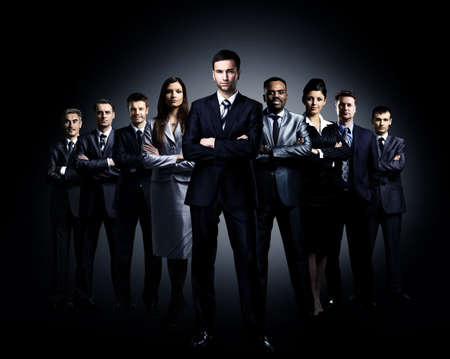 business team standing over a dark background Stock Photo - 29170013