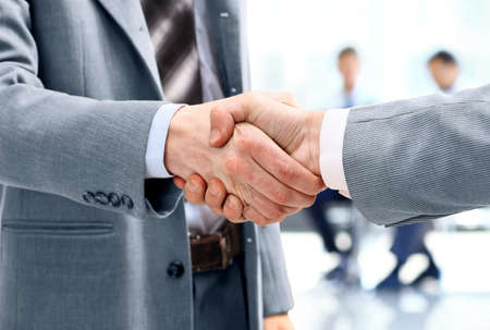 Close up of Businessmen shaking hands  Standard-Bild - 29170014
