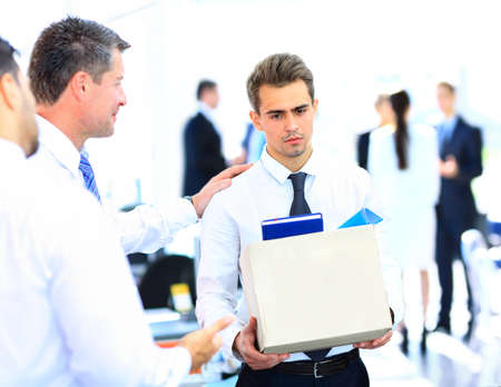 dismissal: dismissed businessman carrying box Stock Photo