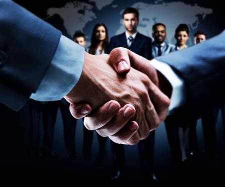 unite: handshake isolated on business background