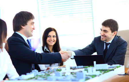 Business people shaking hands, finishing up a meeting photo