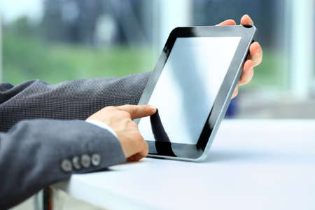 Businessman holding digital tablet photo