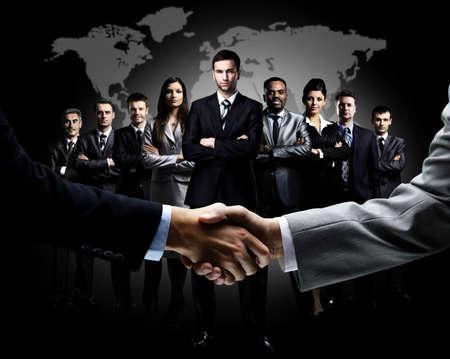 Handshake auf betriebswirtschaftlichen Hintergrund isoliert Lizenzfreie Bilder