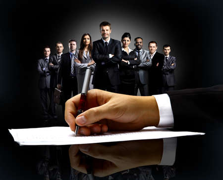 businessman's hand with pen Stock Photo - 29169923
