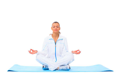 A lotus position in practise of yoga - on white background Stock Photo