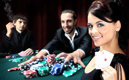 poker: Poker players sitting around a table at a casino Stock Photo