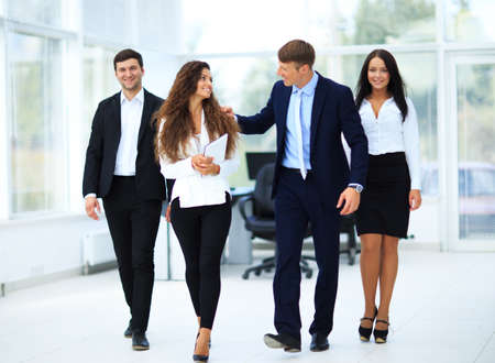 going: Happy businessman going in front of her team Stock Photo