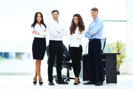 standing together: group of businesspeople standing together in office