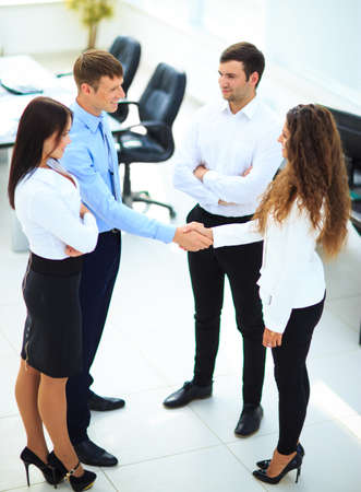 team communication: businessman shaking hands to seal a deal with his partner
