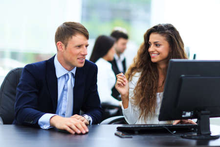 office meeting: Businessman and businesswoman meeting In modern office