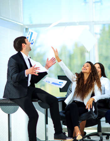people laughing: business people excited happy smile, throw papers, documents fly in air Stock Photo