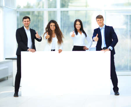 young add: Business group with banner in office