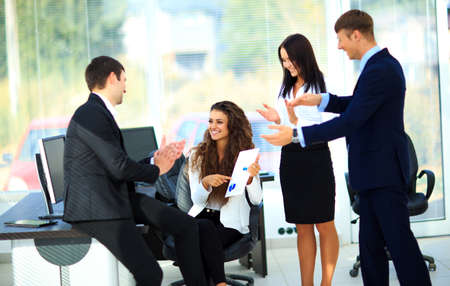 acclamation: Young businesspeople clapping for female colleague after presentation Stock Photo