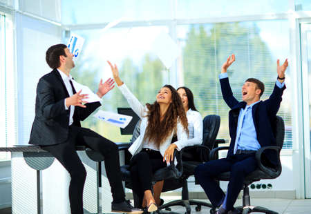 businessman in office: business people excited happy smile, throw papers, documents fly in air Stock Photo