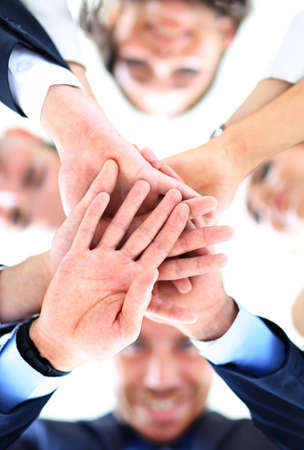 joining hands: Small group of business people joining hands, low angle view Stock Photo
