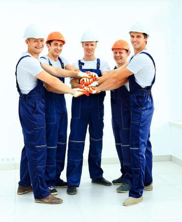 obreros trabajando: Grupo de trabajadores de la industria profesionales Foto de archivo