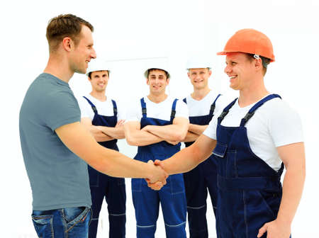 Customer Shaking Hands With Builder Stock Photo