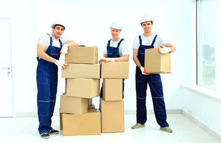 unload: workers unload boxes Stock Photo