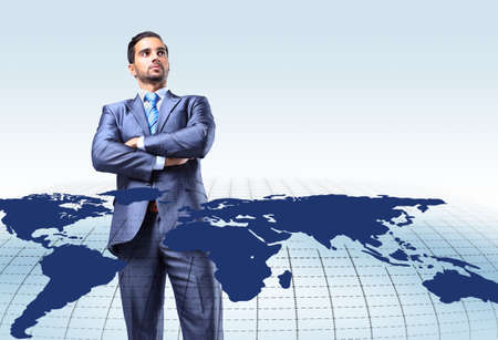 internet globe: Young attractive businessman with world map
