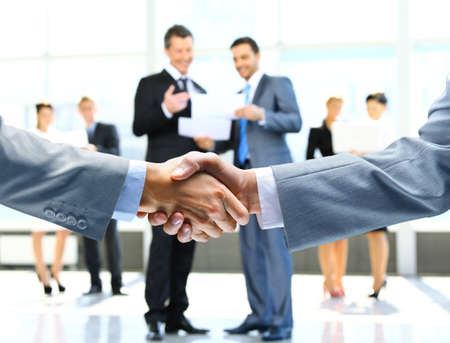Business handshake and business people Banco de Imagens