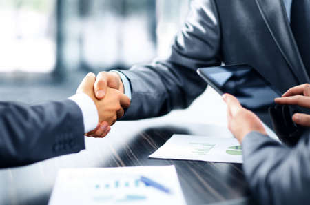 business technology: Business people shaking hands