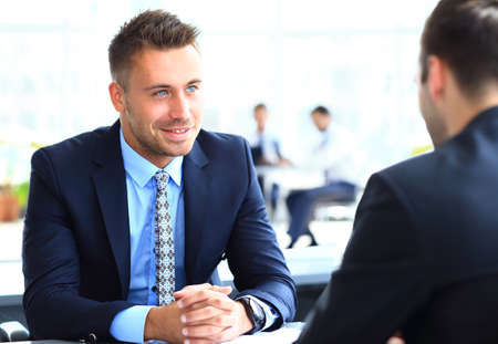 Image of smart businessman explaining new strategy to his partner at meeting